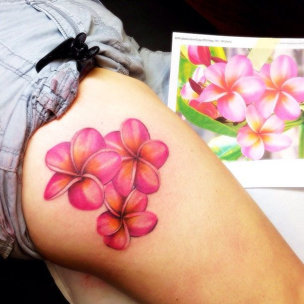 plumeria tattoo on thigh
