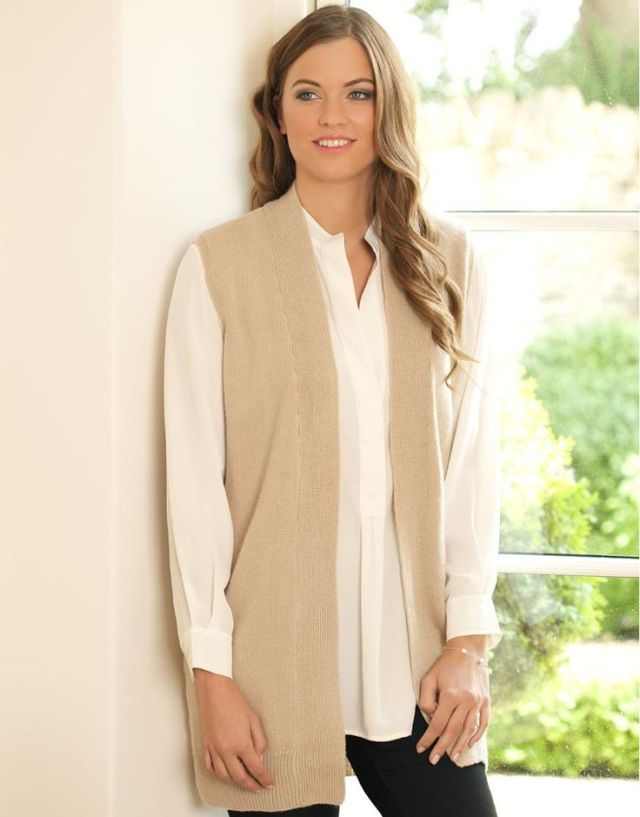 white shirt long sleeveless cardigan outfit
