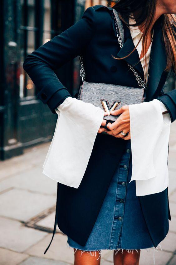 black coat white shirt denim skirt