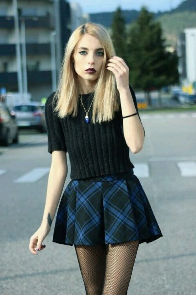 black knit sweater with plaid mini flare skirt