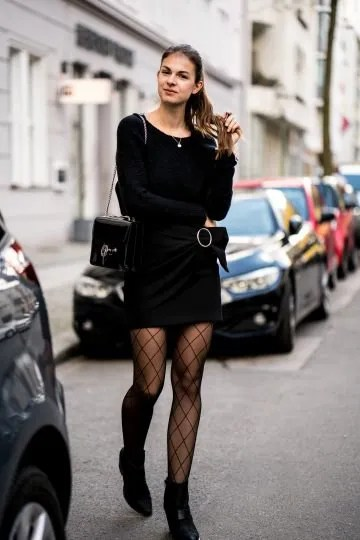 wear with black knit sweater black skirt