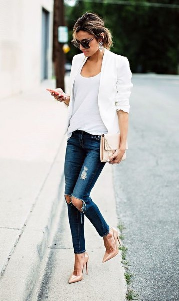 white blazer layered over vest top