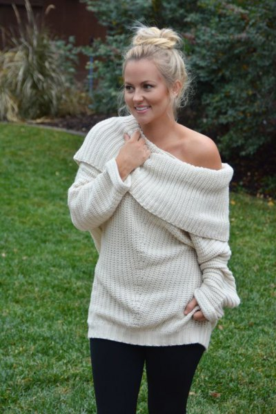 white off shoulder sweater over black leggings