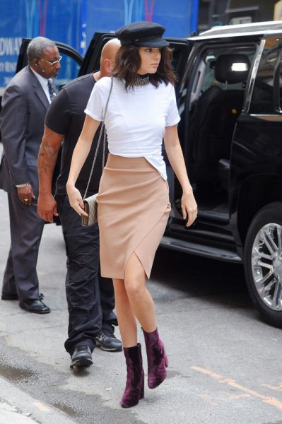 black boots white top pink pencil skirt