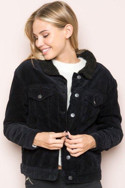 black corduroy jacket white knit sweater
