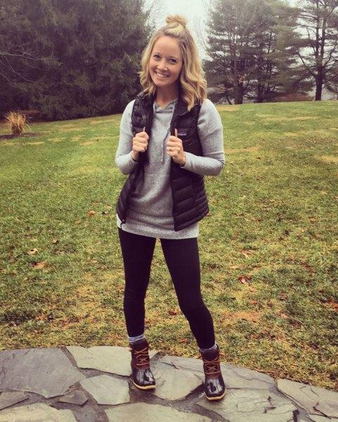 black down vest grey sweater black hiking boots
