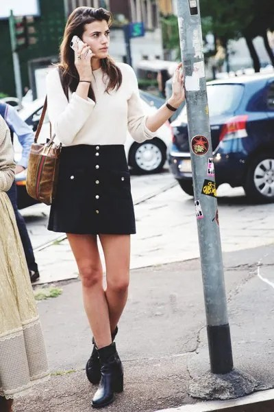 black skirt white knit sweater outfit