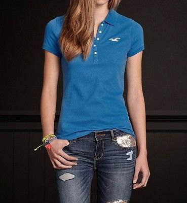 blue polo shirt with ripped jeans