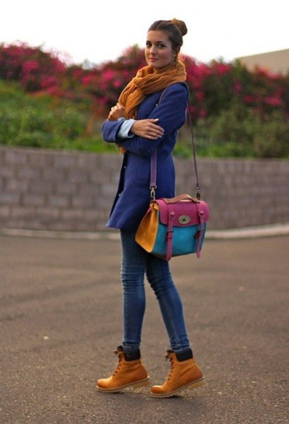 blue trench coat green scarf timberland