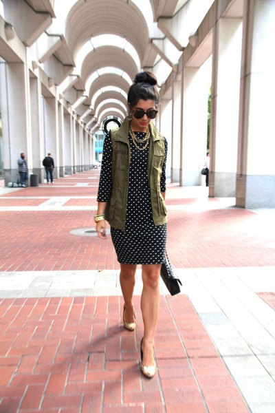 cargo vest over black and white polka dot dress