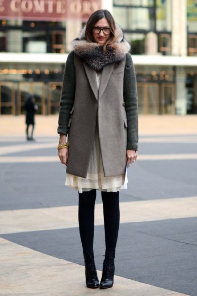 cream dress army green coat black boots