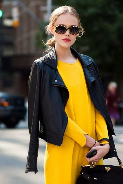drape black leather jacket over shoulders yellow dress