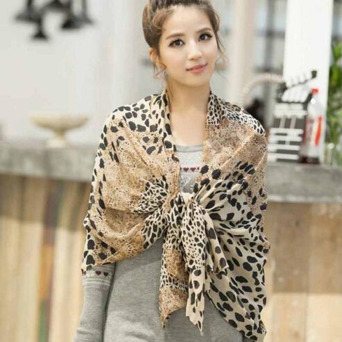 drape cheetah chiffon scarf over shoulder