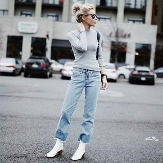 form fitting grey knit sweater jeans outfit