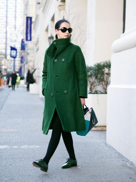 green coat black leggings oxford shoes