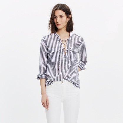 grey and white striped lace up shirt white jeans