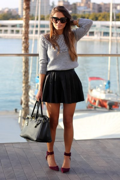 grey sweater black mini skirt