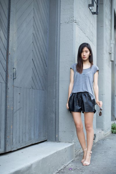 grey t shirt black leather shorts