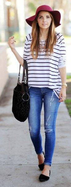 navy and white striped t shirt black floppy hat