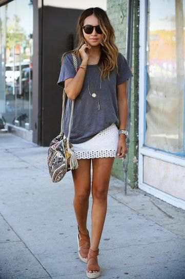 partially tucked oversized t shirt white skirt