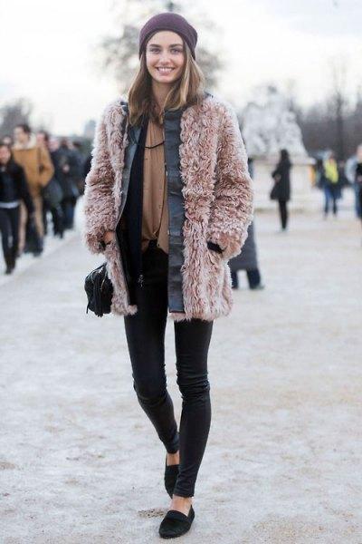 pink teddy coat black skinny pants