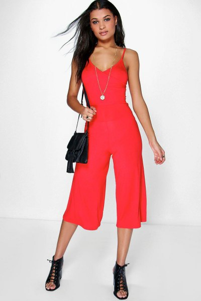 red deep v neck jumpsuit open toe boots