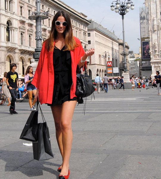 red oversized shirt black shift dress ballet shoes
