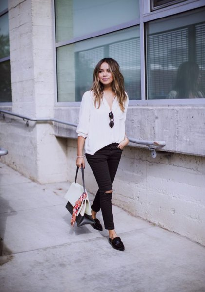 white blouse black skinny jeans loafers