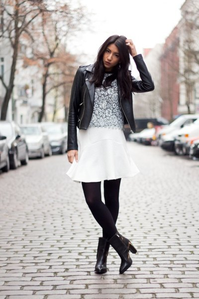 white flare skirt black leggings boots