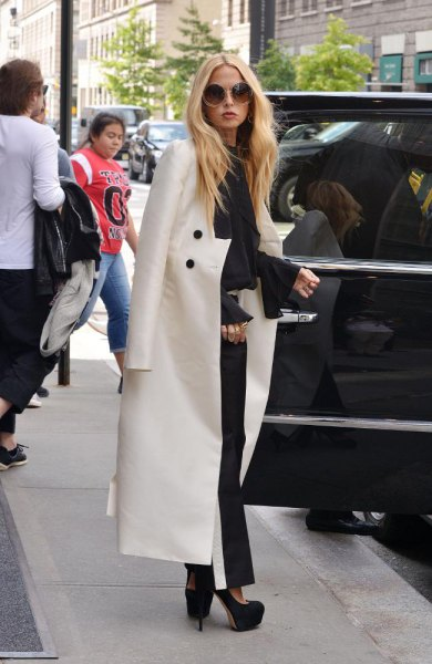 white maxi blazer draped over shoulder