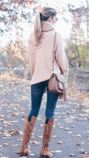white sweater with high lace up suude boots