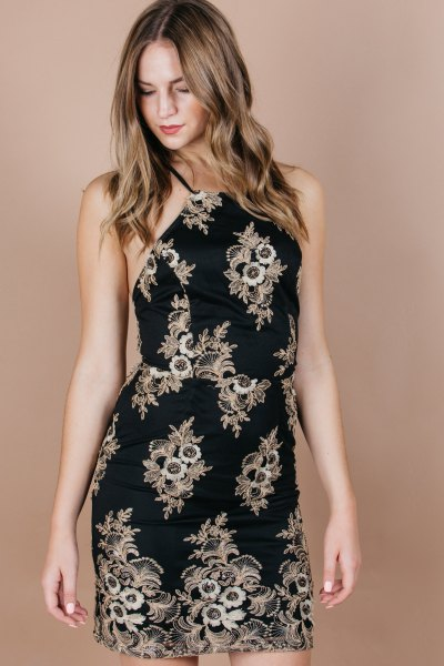 black knee length halter dress gold tribal pattern