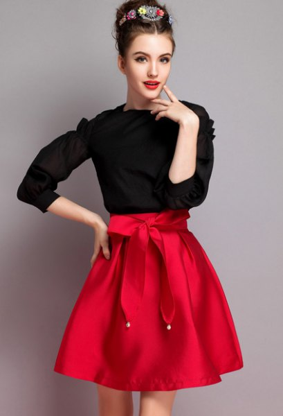 black knit sweater red knotted flare skirt