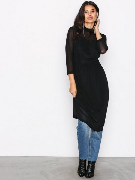 black sheath midi dress over jeans