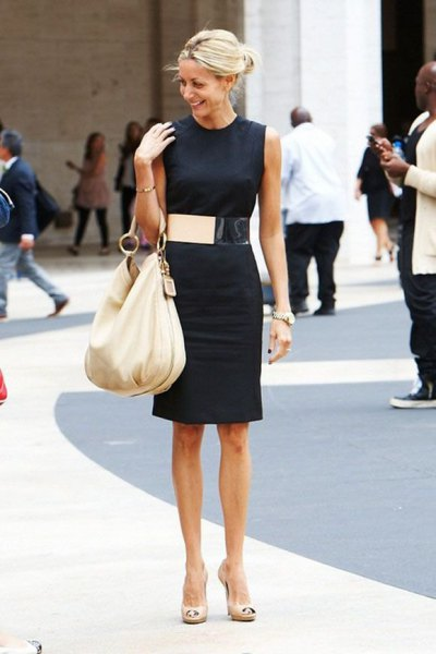 black sleeveless shift dress wide gold belt