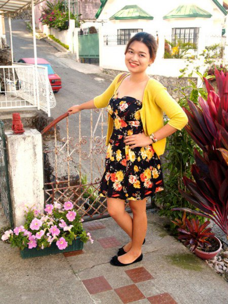 black strapless floral dress yellow sweater