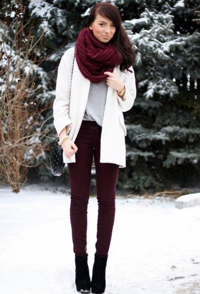 brown scarf white wool coat black corduroy pants