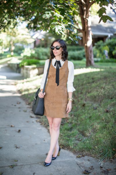 brown suede shift dress over white bow shirt