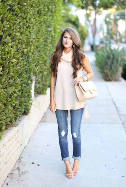 cream cowl neck sleeveless sweater cuffed jeans