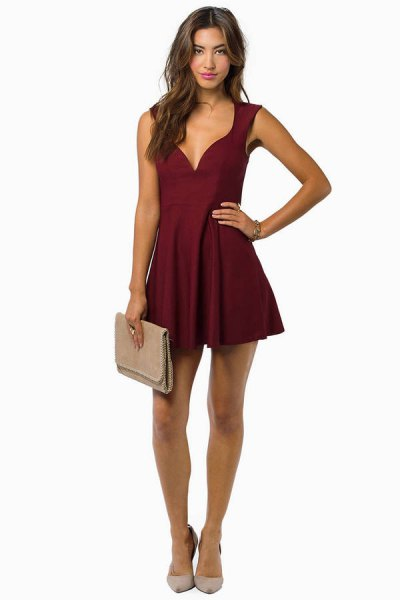 deep v neck burgundy dress pink clutch bag
