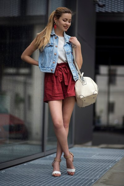 denim vest red belted shorts