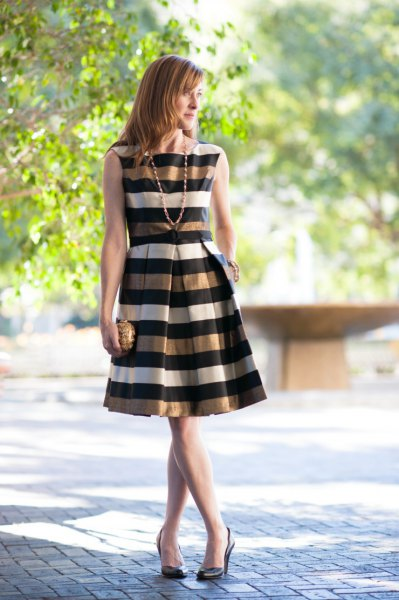 gold black white striped sleeveless flare dress