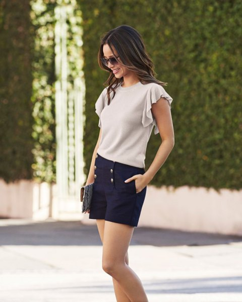 ivory flutter sleeve top high waisted navy shorts