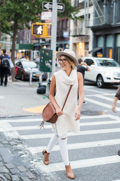 ivory long turtleneck sleeveless sweater white jeans