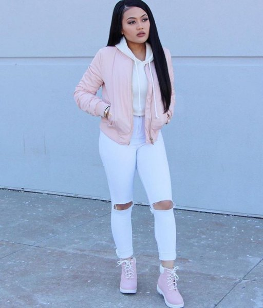 pink bomber jacket white ripped jeans