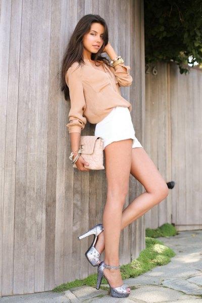 pink knit chunky sweater white pants