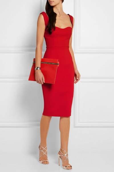 red bodycon midi dress clutch bag