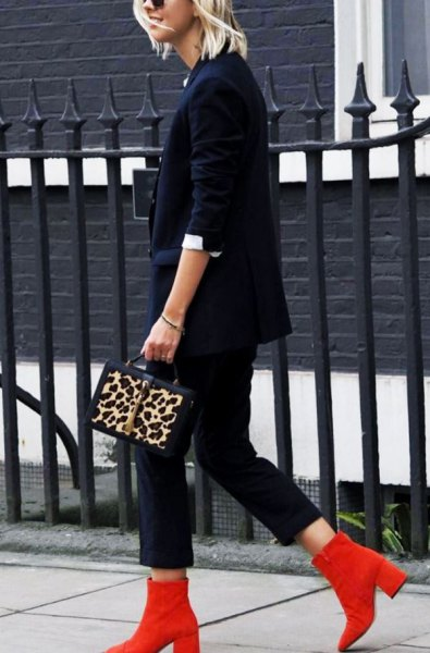 red boots navy suit cheetah purse