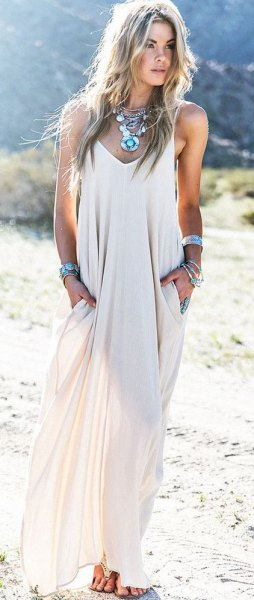 white boho style flowy floor length dress