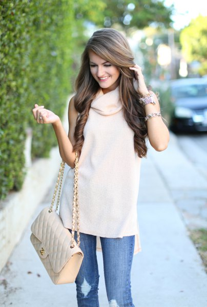 white cowl neck sleeveless sweater ripped jeans